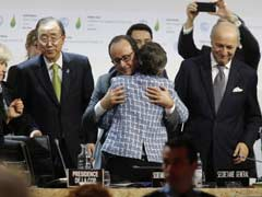 Tears, Cheers And Selfies As Climate Pact Sealed In Paris