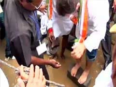 Former Union Minister Holds Slippers for Rahul Gandhi in Flooded Puducherry