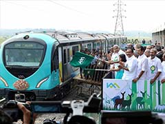 Kerala Chief Minister Oommen Chandy Flags Off First Trial Run Of Kochi Metro