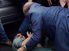 BJP Legislator OP Sharma Seen Beating Man Outside JNU Hearing