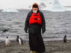 Russian Patriarch Strolls With Penguins On Antarctica Trip