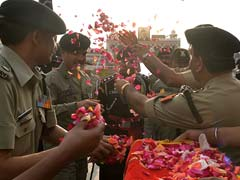 BSF, Pakistan Rangers Celebrate Floral Holi At Wagah Border