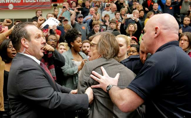 Hecklers Disrupt Donald Trump Rally, Photographer Shoved To The Ground