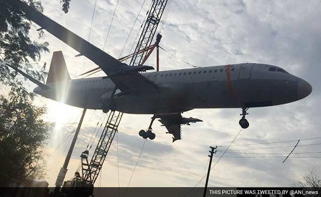 In Pics Hyderabad Watches A Plane Fall Onto A Building While Being Moved