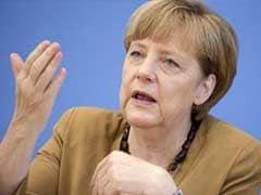 Angela Merkel Lends Backing To Halt Rise Of France's Far-Right