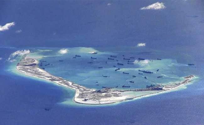 दक्षिणी चीन सागर में विवादित द्वीप पर 'पहली बार' उतरा चीनी सैन्य विमान