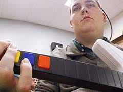 Breakthrough Brain Chip Gives Paralyzed Man Ability To Hold Cup, Play Guitar Hero