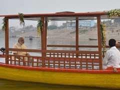 वाराणसी में पीएम मोदी ने की पहले ई-रिक्शा और फिर ई-बोट की सवारी