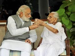 PM Modi Meets His Mother During Gujarat Visit