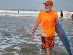 India's 'Surfing Swami' Preaches The Virtues Of The Perfect Wave Repeating