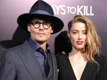 Amber Heard Calls Police as Johnny Depp Retrieves His Items