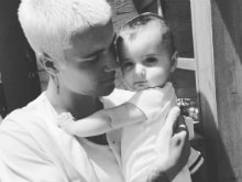 Justin Bieber Posts Pic With a Baby Girl. The Caption is 'Just' a Joke