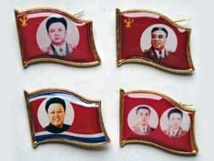 Lapel Pins With Images Of Ex-North Korean Ruler Found In South Korea