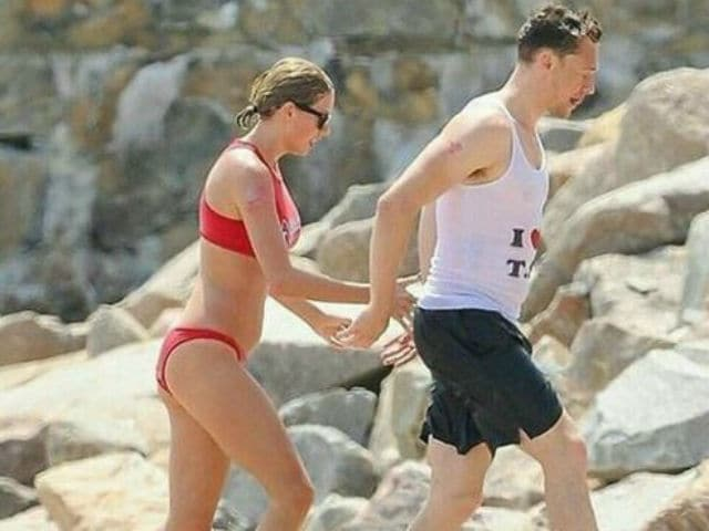 Taylor Swift, Tom Hiddleston Celebrate July 4 With a Beach Party