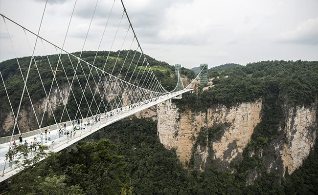 Opens Worlds Highest And Longest Glass Bridge - China opens worlds longest skywalk