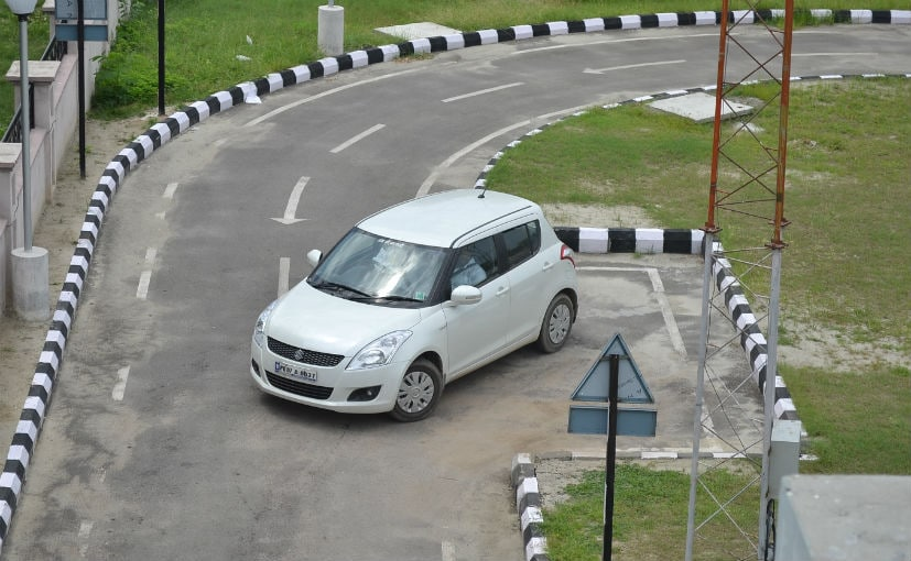 An Licant Is Seen Trying To Parallel Park His Car
