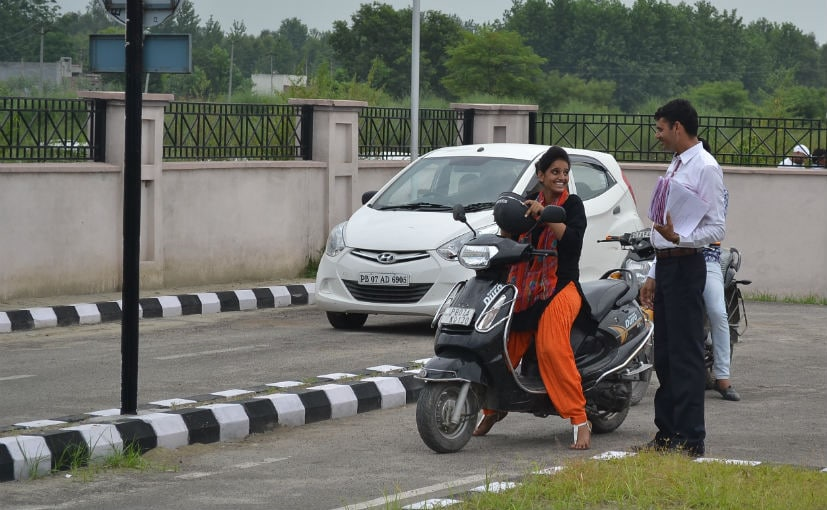 Applicant for a 2-wheeler D/L interacting with an RTO official