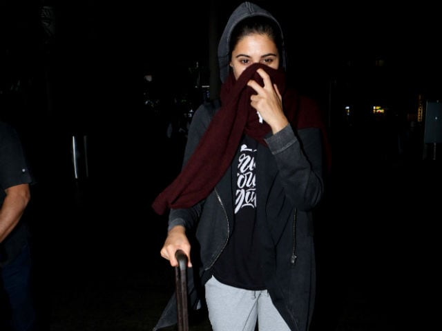 Nargis Fakhri Returns to India But Why is She Hiding Her Face?