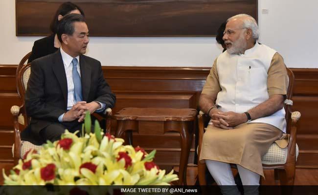 एनएसजी सदस्यता पर टकराव के बीच चीन के विदेश मंत्री ने पीएम मोदी से मुलाकात की