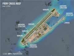 Satellite Photos Suggest China Built Reinforced Hangars On Disputed Islands: Report