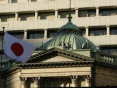 Bank Of Japan Keeps Policy On Hold, Brightens View Of Economy