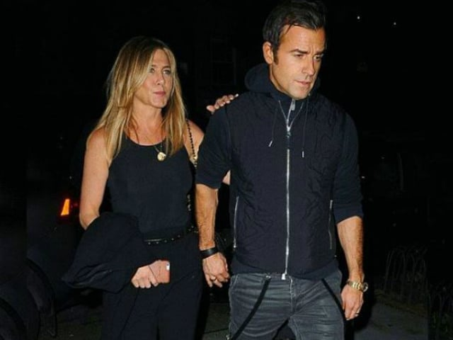 Spotted: Jennifer Aniston And Husband Justin Theroux, Hand-In-Hand