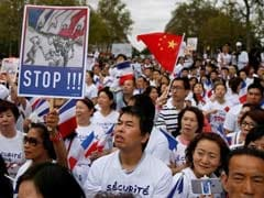 13,000 Attend Paris Rally To Protest Crimes Against Chinese