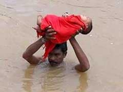 Just Like <i>Baahubali</i>, This Photo Of Andhra Dad Carrying Sick Baby
