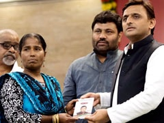 Akhilesh Yadav Distributes Ration Cards Bearing His Photo, Opposition Objects