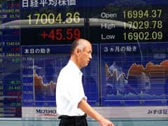 Asian Shares Rise, Crude Oil Hits 2-Year High