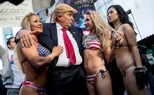 Bikini-Clad Models Surround Fake Donald Trump In New York City Stunt