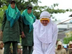 Woman Screams In Pain During Caning In Indonesia As Crowd Cheers