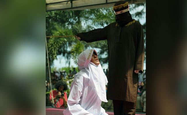 Indonesian Woman Screams As Crowd Cheers During Caning At Mosque