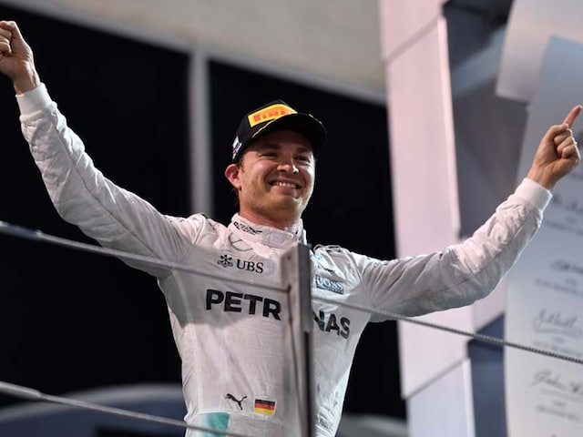 Nico Rosberg Staves Off Lewis Hamiltons Challenge To Win Maiden F1 World Title