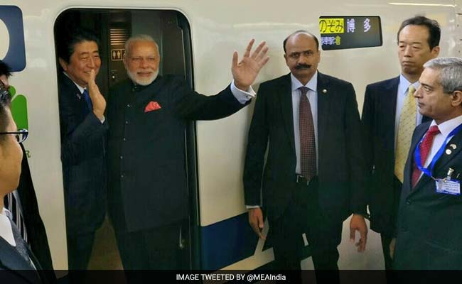 Abe leaves for India for talks with Modi, new railway event