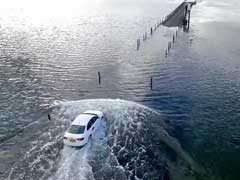 Dramatic Drone Footage Captures Uber Racing Rising Tide On Causeway