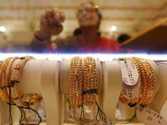 Gold Hits Four-Week High As Dollar Weakens