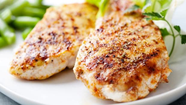 An easy recipe for baked chicken breast for two that is marinated in Mediterranean flavors like lemon juice, olive oil, garlic, and herbs.