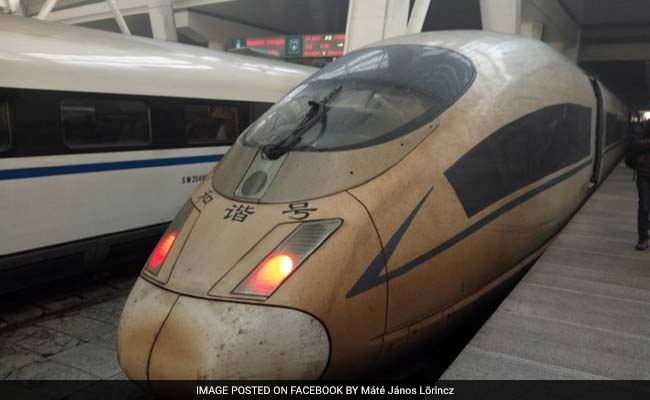 China's Bullet Trains Turn Brown As Smog Crisis Intensifies