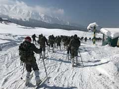 Snow-Covered Gulmarg Buzzing With Tourists Gliding Down Ice