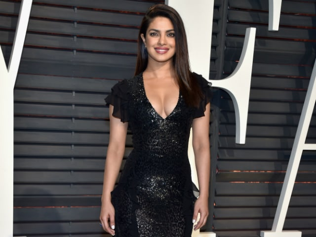 Priyanka Changes Out Of Red Carpet Silver Into Black