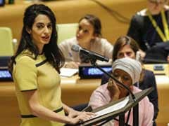 Amal Clooney Talks Genocide At UN. TIME Tweets On Baby Bump Instead