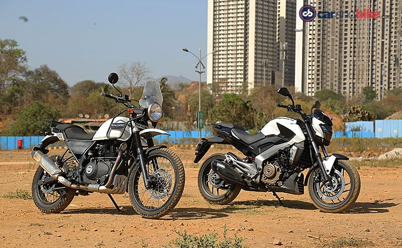 bajaj dominar vs re himalayan comparison