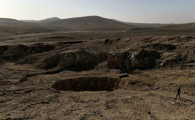 ISIS Dumped Bodies In Sinkhole, But Full Scale Of Killings Might Not Be Known For Years