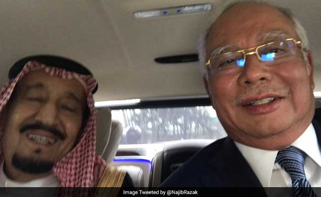 Saudi King Salman Embraces 'Selfie' On Tour Across Asia