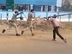 Armed With Sticks, Locals In West Bengal Chase Away Police On Camera