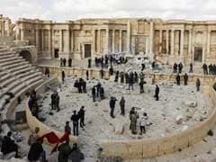 Atop Palmyra's Damaged Theatre, Syrian Musicians Sing Of Return