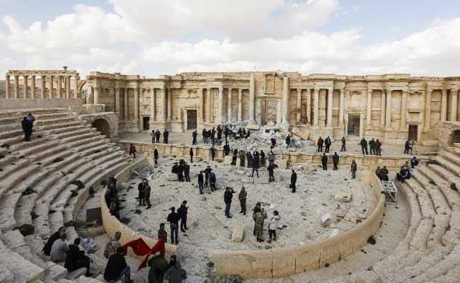 atop palmyras damaged theatre syrian musicians sing of