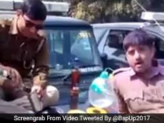 बीएसपी ने ट्वीट किया वीडियो, यूपी डायल 100 की गाड़ी पर शराब पी रहे पुलिसकर्मी