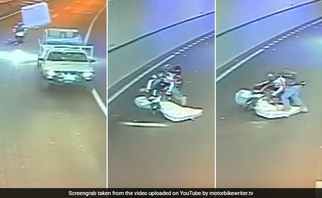 Caught On CCTV: Flying Mattress Hits Biker, But Also Saves His Life